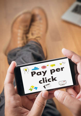 adwords: PPC - Pay Per Click concept Businessman working concept
