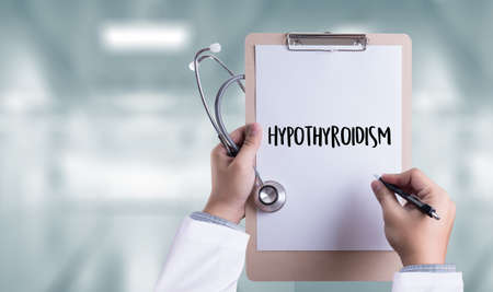 acquired: Hypothyroidism doctor hand working Professional Medical Concept