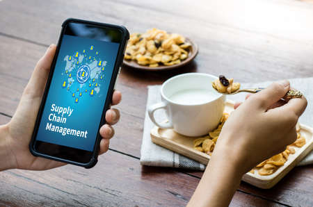 SCM Supply Chain Management concept Modern people doing business, graphs and charts being demonstrated Stock Photo
