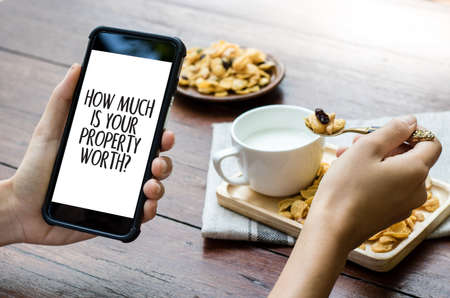 HOW MUCH IS YOUR PROPERTY WORTH? Stock Photo