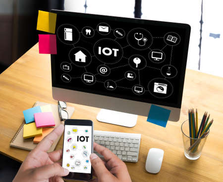 enveloped: IOT business man hand working and internet of things (IoT) word diagram as concept Stock Photo