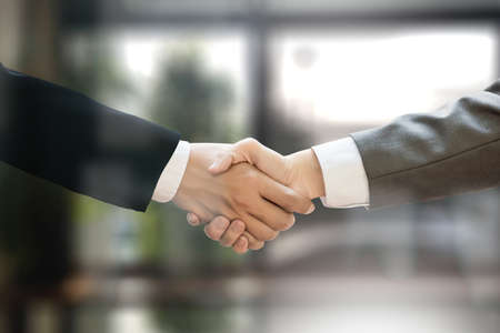 M&A (MERGERS AND ACQUISITIONS) , Businessman handshake working at office M&A Stok Fotoğraf - 77883354