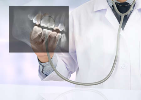 odontology: Dental x-ray Doctor holding and looking and Healthcare medicine