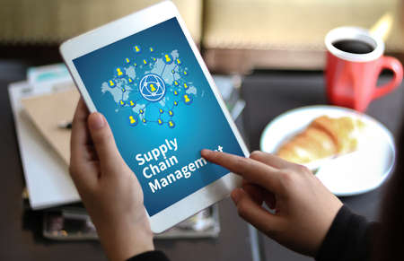 variance: SCM Supply Chain Management concept Modern people doing business, graphs and charts being demonstrated Stock Photo