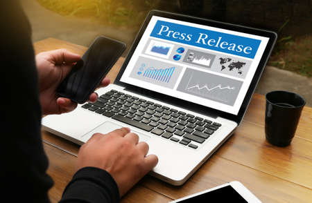 Press Release  concept, Thoughtful male person looking computer Stock Photo
