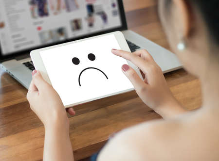 Depressive emotions concept,   smiley face emoticon printed.