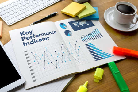 KPI acronym (Key Performance Indicator) Business team hands at work with financial reports and a laptop Stock Photo - 82110793