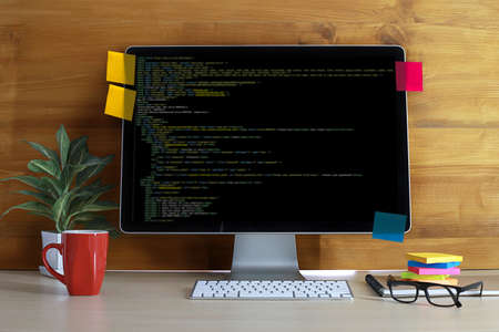 html: Developer team working laptop computer mobile application software and web design online technology content script to display Stock Photo