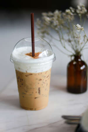 Iced coffee whipped milk  in coffee shop on table Stock Photo