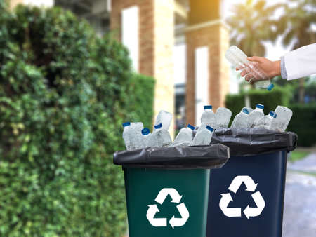 man hand putting plastic reuse  for recycling concept environmental protection world recycle Stock Photo