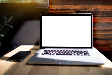 Workspace background new project on laptop computer with blank copy space screen for your advertising text message Laptop with blank screen on table. 版權商用圖片