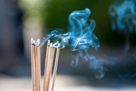 burning Embossed  sticks and smoke from incense burning and smoke Imagens