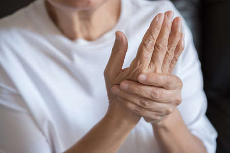 Elderly woman suffering from pain From Rheumatoid Arthritis