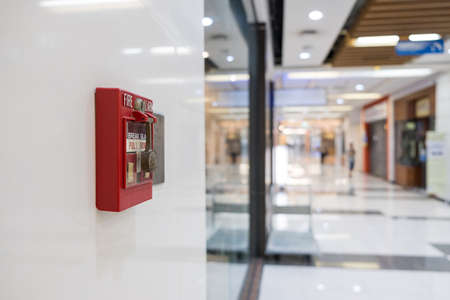 Fire alarm on the wall of shopping mall warning and security system 版權商用圖片