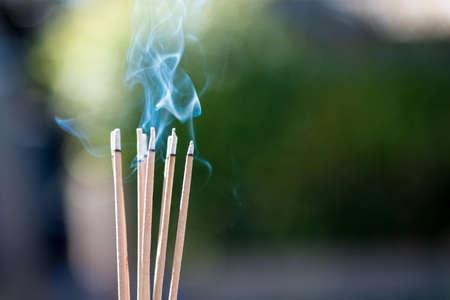 burning Embossed  sticks and smoke from incense burning and smoke 스톡 콘텐츠