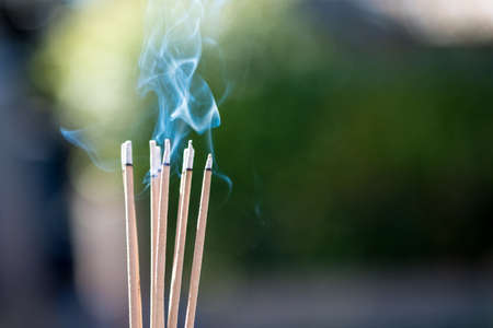 burning Embossed  sticks and smoke from incense burning and smoke 스톡 콘텐츠