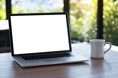 Laptop with blank screen on table. Workspace background new project on laptop computer with blank copy space screen for your advertising text message