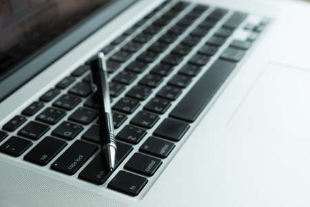 Top view of pen on laptop Stock fotó
