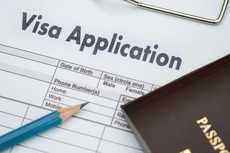 Visa application form to travel Immigration a document Money for Passport Map and travel plan Imagens