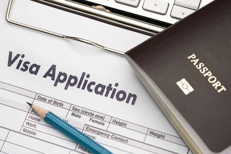 Visa application form to travel Immigration a document Money for Passport Map and travel plan Standard-Bild