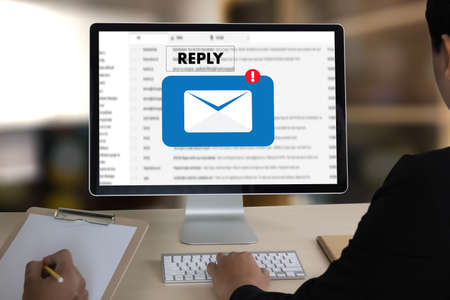 reply the message email on computer Businessman is working to important reminder Stock Photo