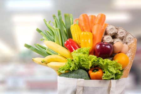 Eco day use shopping bag with vegetables grocery shopping in supermarket