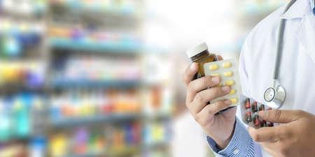 doctor holding  Pharmacist in pharmacy drugstore Medicine Stock Photo