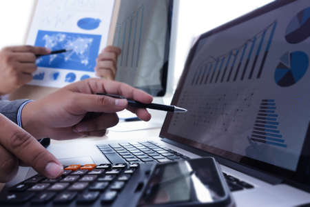 analyzing the work Accounting on Laptop  investment concept. Stock Photo