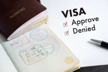Visa and passport to approved stamped on a document top view in Immigration Visa approve Standard-Bild