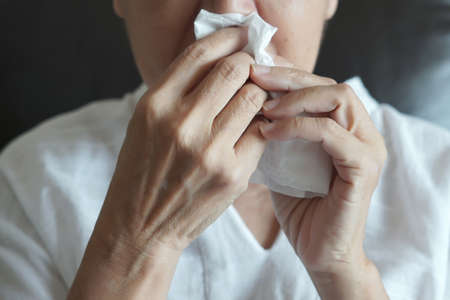 Elderly female robes feeling unwell just caught cold