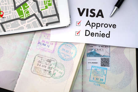 Visa and passport to approved stamped on a document top view in Immigration Visa approve Editorial