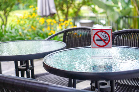 No smoking sign in a cafe and the park