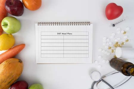 Diet Plan and fresh   fruit and vegetables Living Concept Stock Photo
