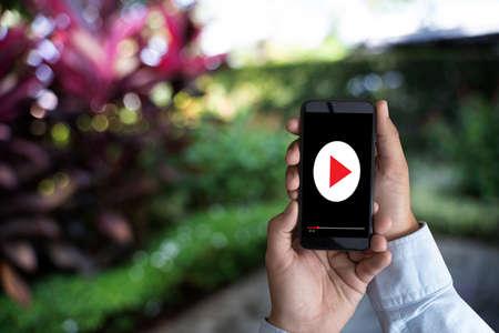 man holding smartphone against VDO ads concept