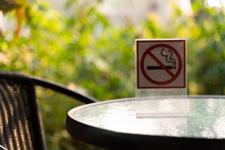 Dont smoke sign with bokeh background with shopping place