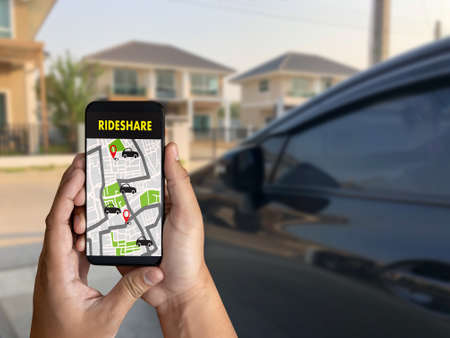 mobile application Ride share taxi service on phone man holding phone