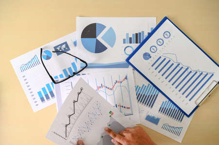 research documents with analytics data Brainstorm Meeting Businessman financial report