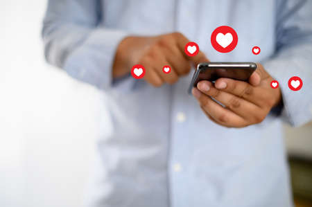 man use Social media,social network  phone message from lovers. Send a message love Stock Photo - 120638864