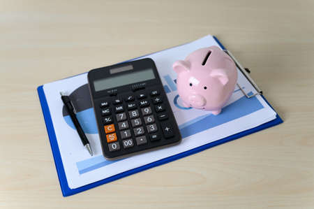 Financial insurance piggy bank with calculator Retirement Plan and Pension