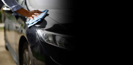 Modern car wash close-up banner background microfiber in hand car wash