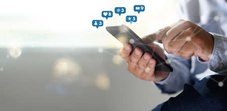Social media,social network concept with smart phone man phone with social media network diagram