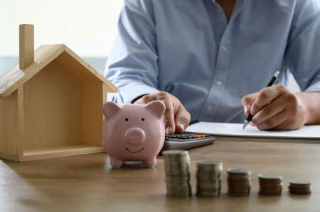 Save money for home cost saving account book or financial statement Home loan, reverse mortgage Foto de archivo