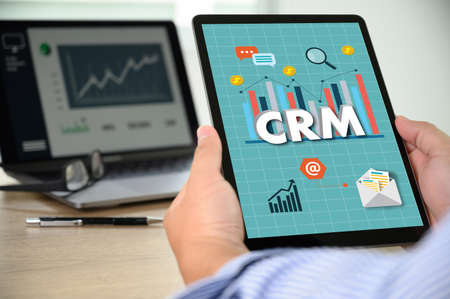 CRM Business Customer CRM Management Analysis Service Concept Business team hands at work with financial reports and a laptop Imagens