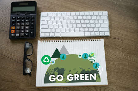 GO GREEN Life Preservation Protection Growth Project About Business Growth GO GREEN , Go Green field friendly man use computer environment  ceo Stock Photo
