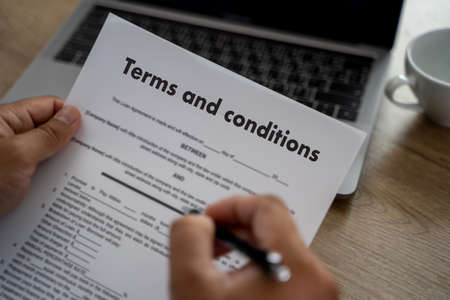 Terms of use confirm terms disclaimer conditions to policy service man use pen Terms and conditions agreement or document Stock Photo