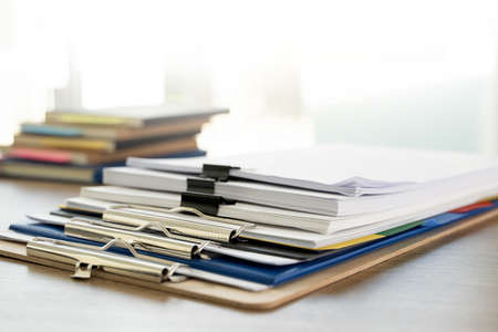 man report stack paper folder close up stacking of office working document with paper legal paperwork on top Stock Photo
