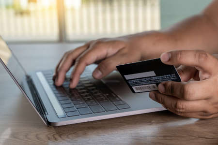 shopping and online payment credit card purchase online businessman mobile payment  on table Stock Photo