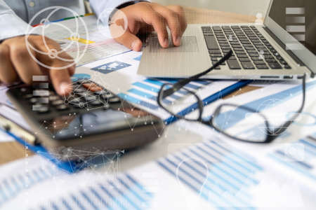 businessman work in office analysis chart graphy planning analyzing financial document data charts using calculator strategy analysis financial