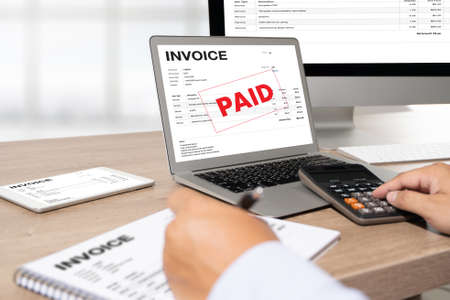 Businessman work Using The Computer Calculating Invoice In Office Invoice Form and Accountant Checking Invoice