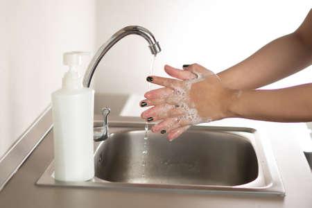 Woman washing hand for corona virus prevention Washing Hands stop spreading coronavirus Hygiene concept Archivio Fotografico
